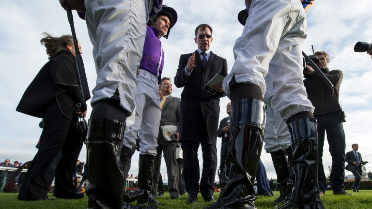 Discussing tactics: Aidan O'Brien debriefs his four riders ahead of the Racing Post Trophy