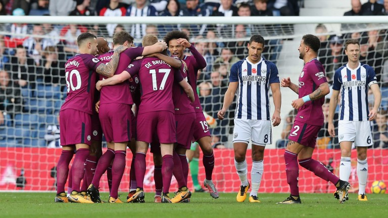 Manchester City celebrate Fernandinho's goal in the win at West Brom