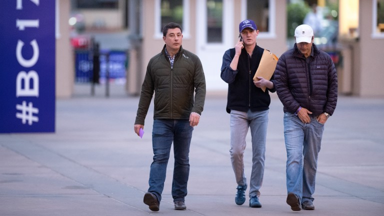George Scott (centre) arrives at Del Mar with Simon Callaghan (left)