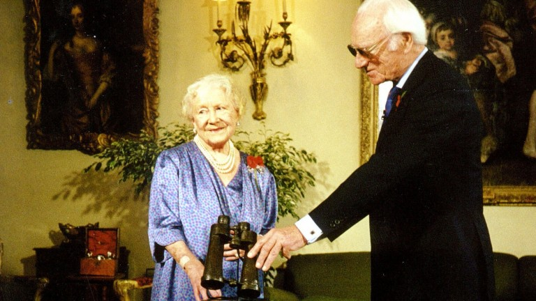 Presenting the Queen Mother with a bronze casting of his personal binoculars for her lifetime's contribution to racing