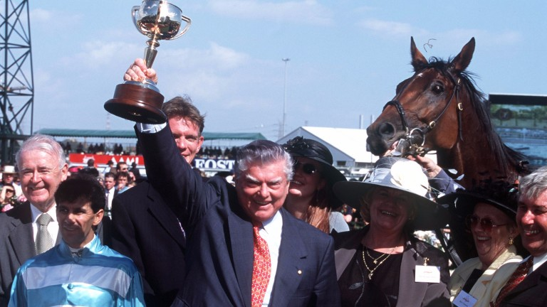 Bart Cummings holds aloft the Melbourne Cup after winning the race in 1999 with Rogan Josh