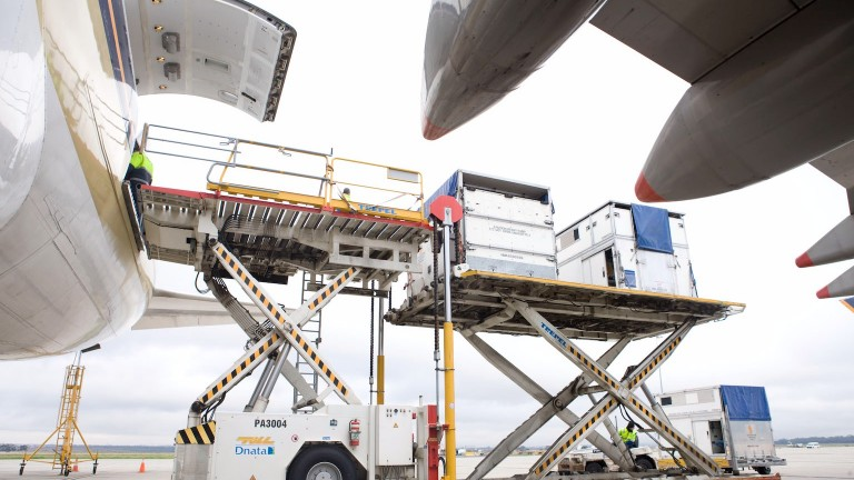 Equine passengers are loaded on to the plane in their crates
