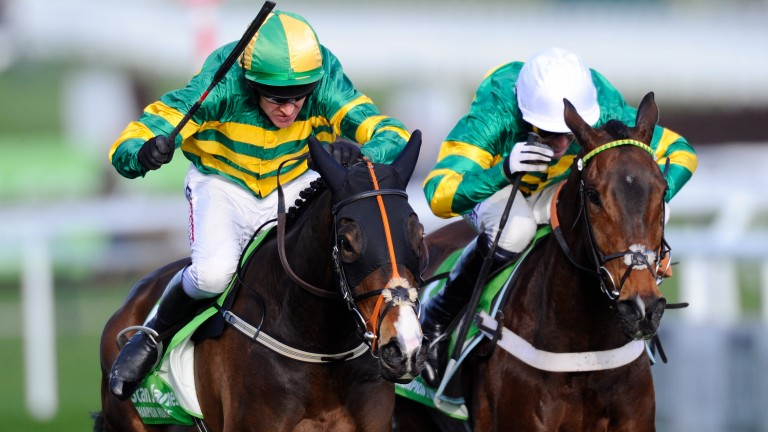 Jezki and Barry Geraghty (left) win the 2014 Champion Hurdle from My Tent Or Yours