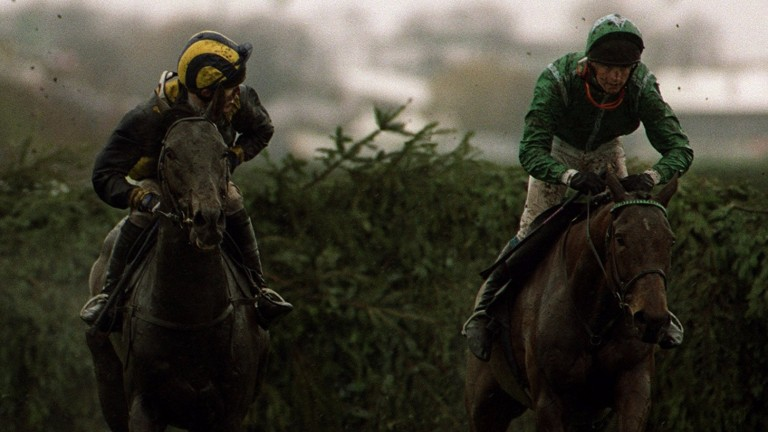 Sir Anthony McCoy and Blowing Wind (left) alongside Papillon in the attritional 2001 Grand National after remounting to finish third