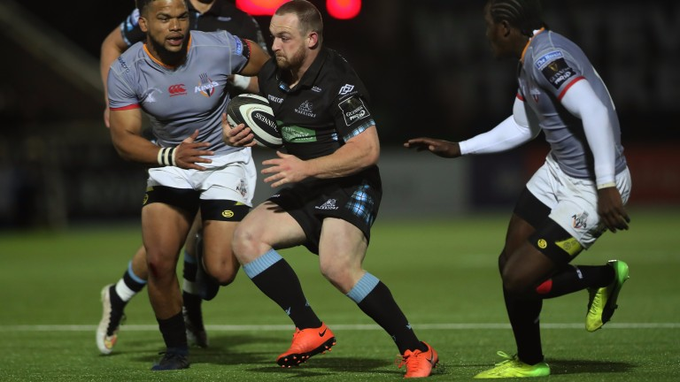 Glasgow centre Nick Grigg stretches the Southern Kings defence