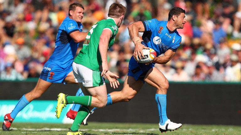 Italy's Mark Minichiello runs at the Ireland defence