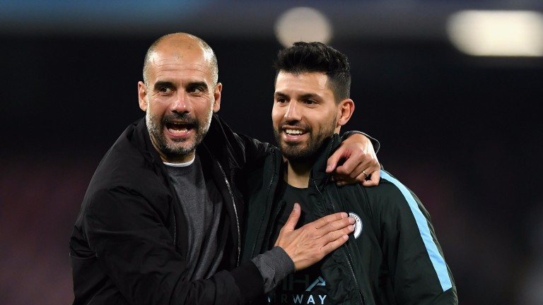 Pep Guardiola and Sergio Aguero celebrate Manchester City's win in Naples