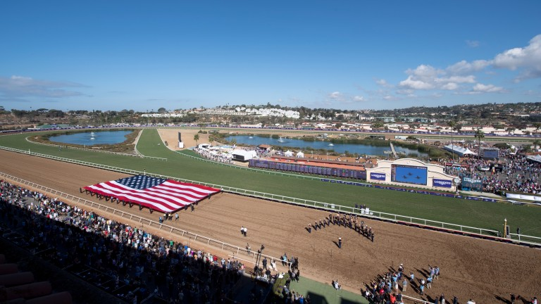 The US flag is paraded as the band marks the starts of Breeders' Cup Saturday at Del Mar