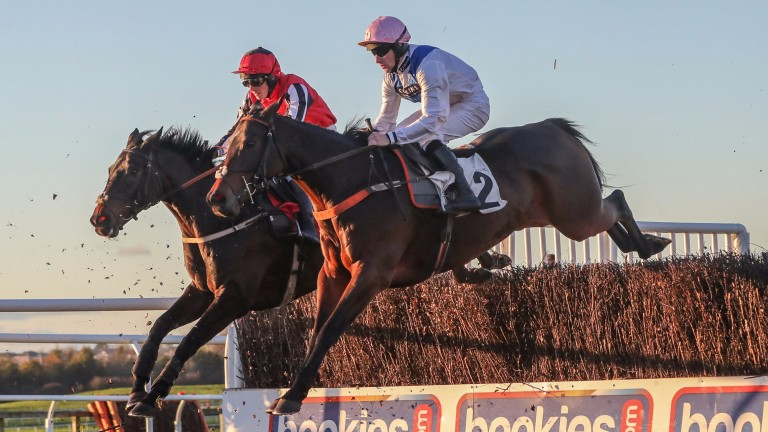 Waiting Patiently (near side, Brian Hughes) made it four from four over fences at Carlisle