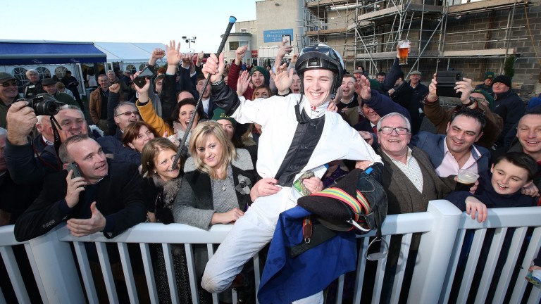 The Naas crowd raise a toast to new champion jockey Colin Keane after he rides his 100th winner of the season