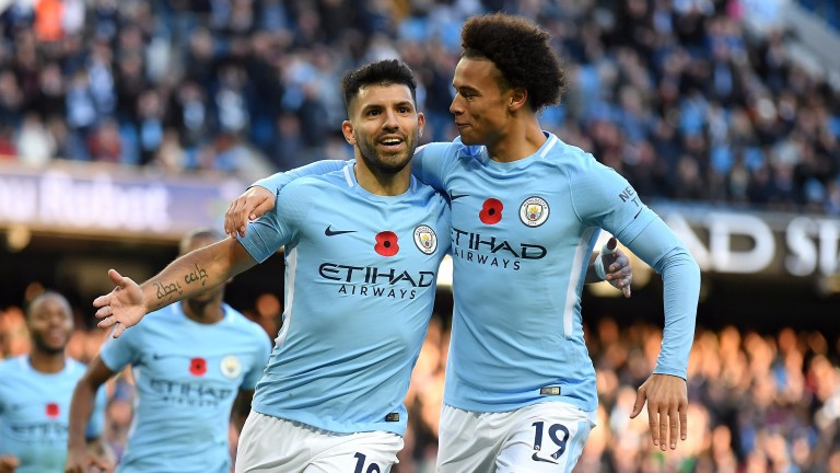 Sergio Aguero (left) and Leroy Sane celebrate a goal for City against Arsenal