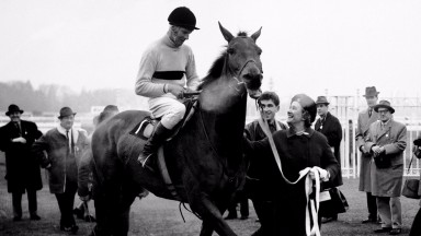 Arkle, ridden by Pat Taafe, is led in by the Duchess of Westminster after winning a race