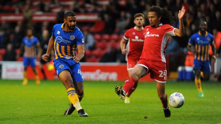 Shrewsbury's Stefan Payne has a pop at goal against Walsall