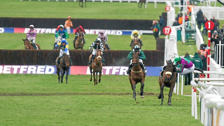 Salsify (left) and Colman Sweeney have the race at their mercy as Oscar Delta (right) unseats Jane Mangan after the last in the Foxhunter