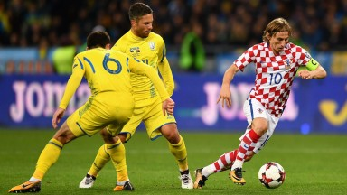 Luka Modric (right) is a class act in midfield for Croatia