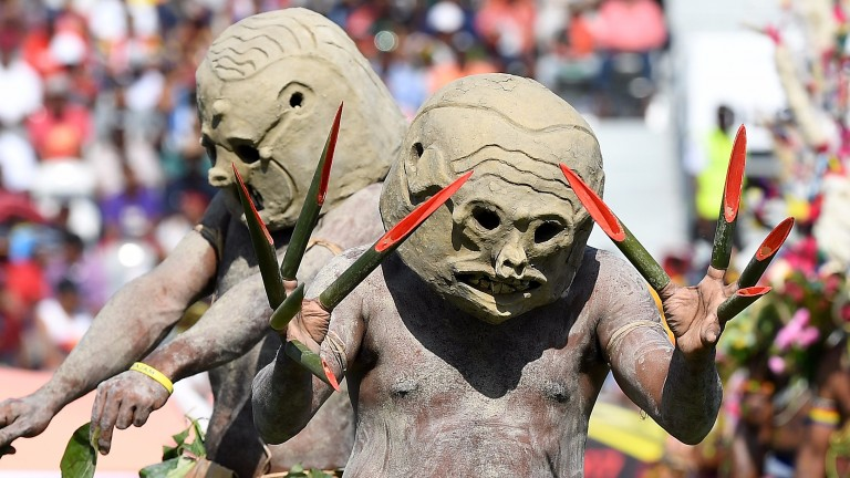 Tribal dancers perform before the match between Papua New Guinea and Ireland