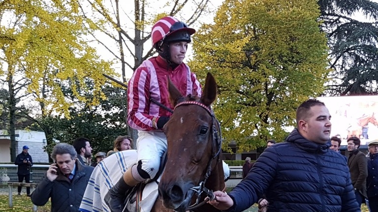 Peterjon Carberry returns to the Auteuil winners' enclosure aboard Docteur De Ballon after winning the Prix General Donnio
