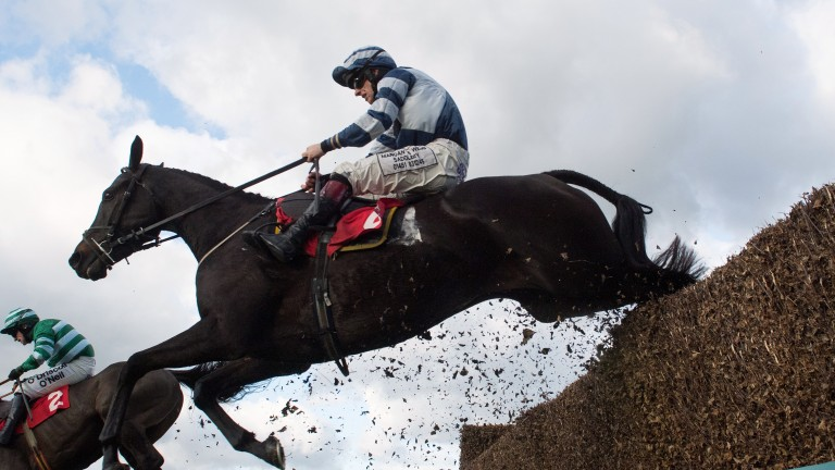 Jameson and Jamie Bargary jump the last fence on the way to victory at Sandown