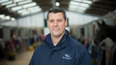 11.11.17 - Tim Vaughan Racing Stable Tour, Cowbridge, South Wales - Tim Vaughan with the horses in one of the barns at his stables