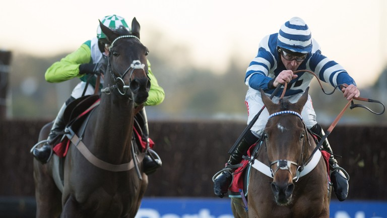 Whisper (Davy Russell, right) beats Clan Des Obeaux in the graduation chase at Kempton on Monday