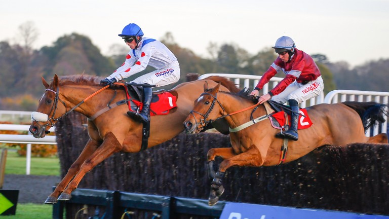 Give Me A Copper and Harry Cobden (far side) on the way to victory over sole rival Three Ways in the novice chase