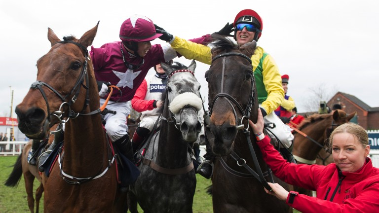 Sizing John: Bryan Cooper congratulates Robbie Power (right) after the Jessica Harrington-trained chaser landed the Gold Cup  at Cheltenham in March