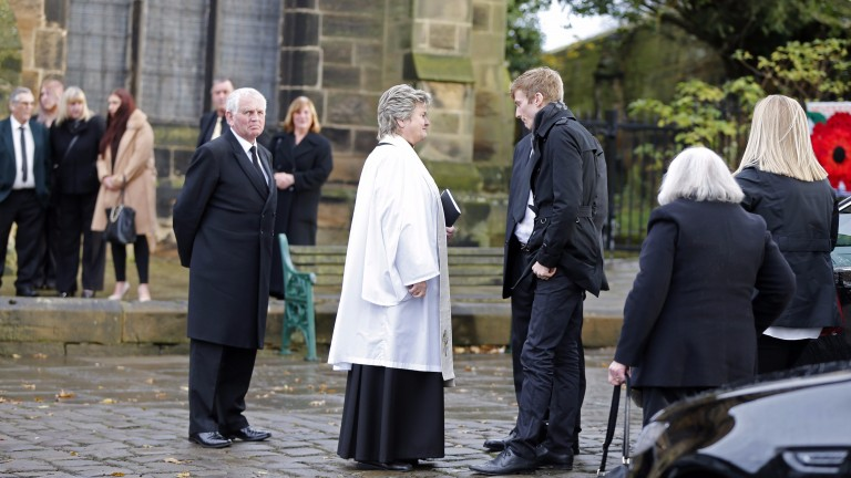 James Reveley in conversation with the Reverend Alison Phillipson before the funeral of his grandmother Mary