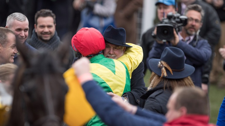 Alan Potts and Robbie Power share a moment after Sizing John's Gold Cup win
