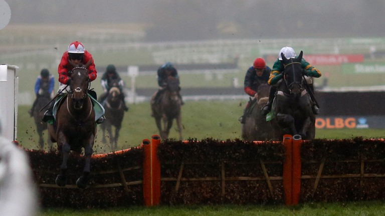Richard Johnson and The New One (left) clear the last ahead of My Tent Or Yours in the 2016 International Hurdle at Cheltenham