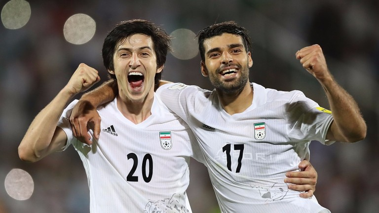 Iran's Sardar Azmoun (left) regularly rides horses