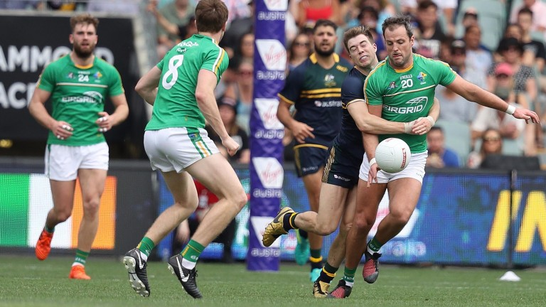 Ireland's Michael Murphy is tackled by Zach Merrett of Australia in the first Test