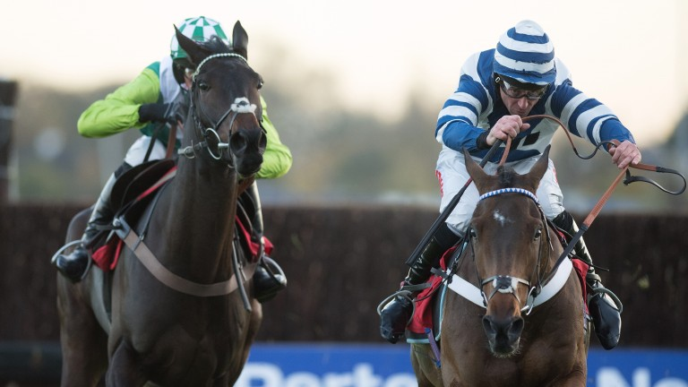 Whisper (Davy Russell, right) beats sole rival Clan Des Obeaux in the graduation chase at Kempton