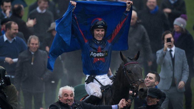 Flying the flag: Tom Bellamy salutes the crowd as Splash Of Ginge is led into the winner's enclosure by owner John Neild