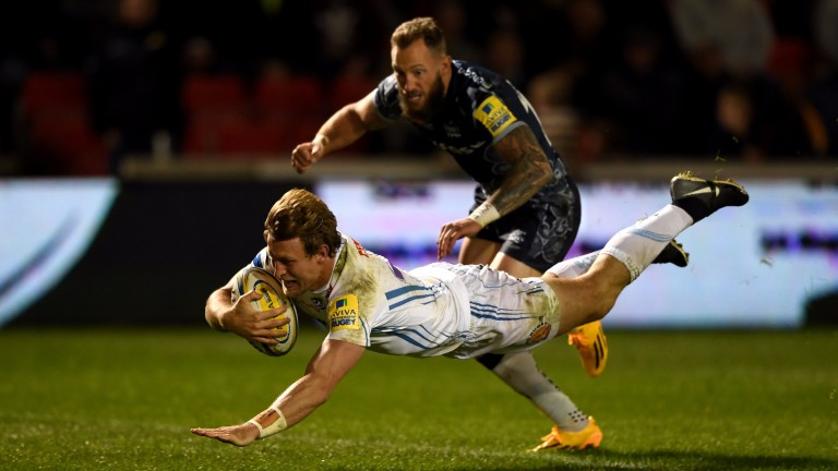 Lachie Turner dives over for Exeter's try against Sale