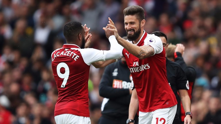 Olivier Giroud (right) is back in contention for Arsenal