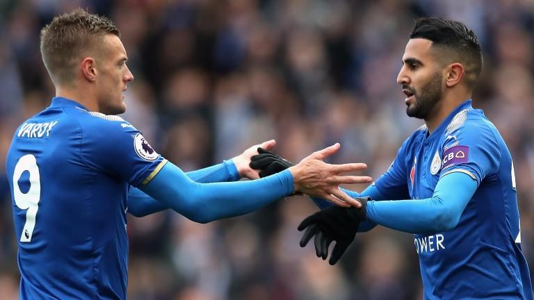 Leicester's number nine Jamie Vardy celebrates with Riyad Mahrez