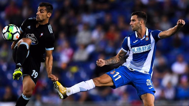 Jonny Castro of Celta Vigo competes for the ball with Leo Baptistao of Espanyol