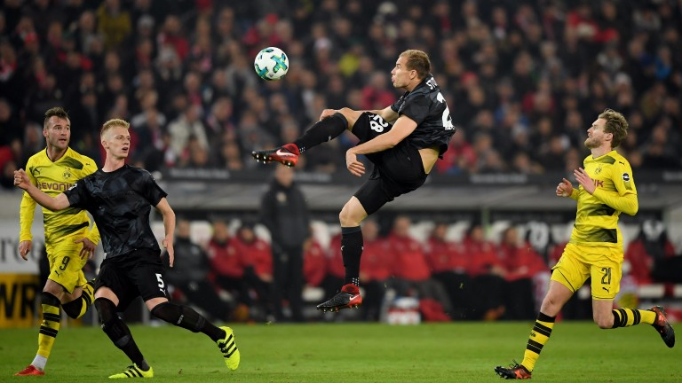 Holger Badstuber of Stuttgart kicks out against Borussia Dortmund