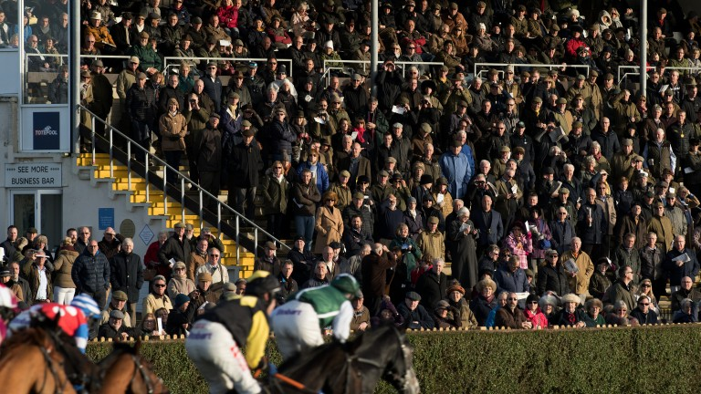 Decent crowd: all eyes on the runners as the field passes the stand, with the race being won by the leader shot Captain Cattistock