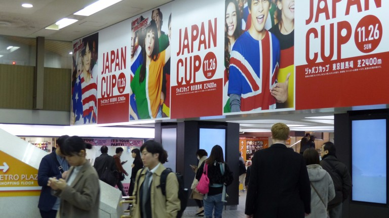 Commuters at Tokyo's Shinjuku station cannot escape the fact that the Japan Cup is being run this Sunday