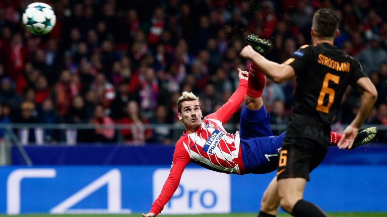 Antoine Griezmann volleys home spectacularly for Atletico Madrid against Roma