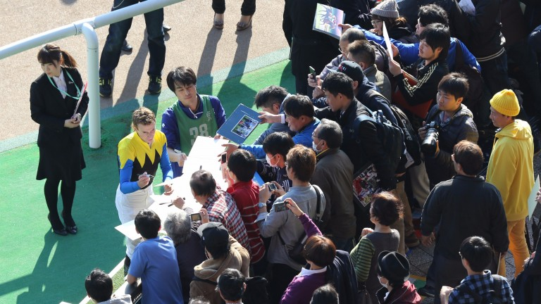 Ryan Moore signing autographs for fans after riding his fifth winner of the day at Tokyo on Saturday