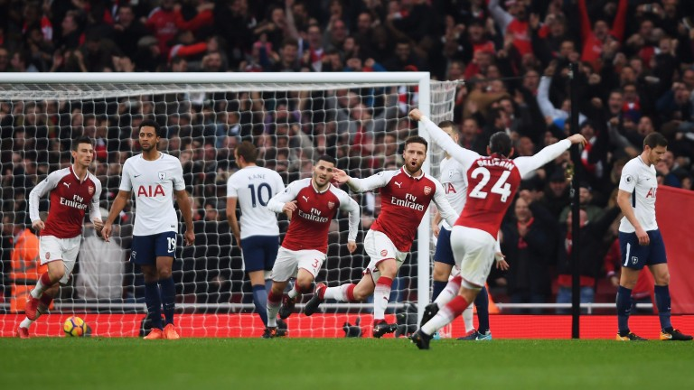 Shkodran Mustafi and Arsenal celebrate their first goal in the north London derby win