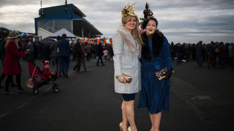 All dressed up: two racegoers pose for a photo