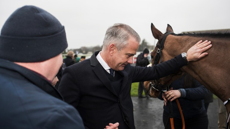 Deserved pat: owner Chris Jones greets Troytown Handicap Chase winner Mala Beach