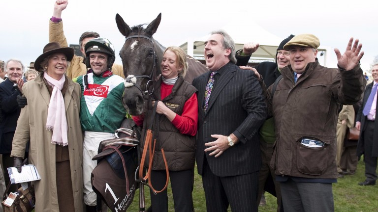 Jubilation in the winner's enclosure at Newbury as Denman's joint owner Harry Findlay (arm raised) celebrates Hennessy success with jockey Ruby Walsh, groom Lucinda Gould and trainer Paul Nicholls