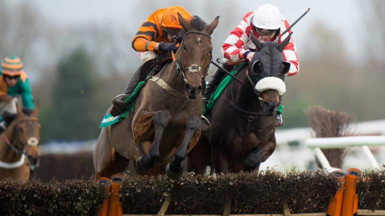 Thistlecrack (Tom Scudamore, left) jumps the final flight with Deputy Dan before pulling clear for a six-length success in the 2015 Long Distance Hurdle at Newbury