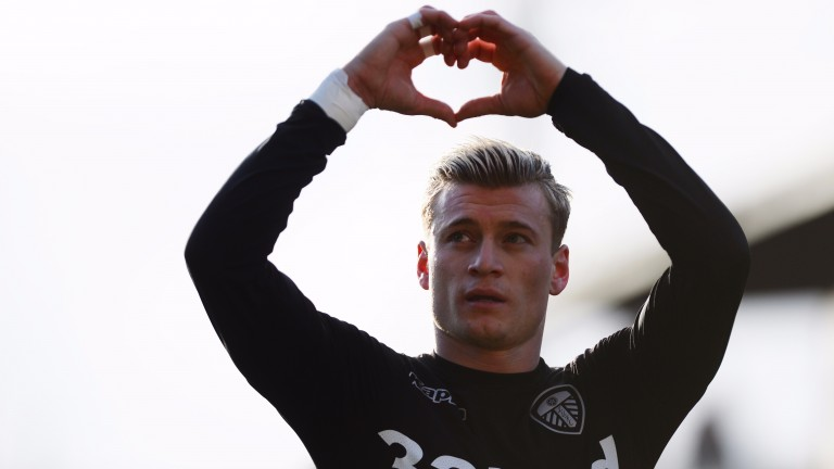 Ezgjan Alioski celebrates a goal for Leeds at Barnsley
