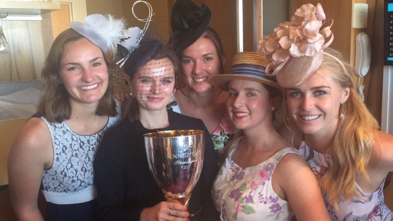 Trainees Madison Scott, Meg Hebbert, Amie Karlsson, Laura Robertson and Jessica Berry get their hands on Gai Waterhouse's VRC Oaks trophy