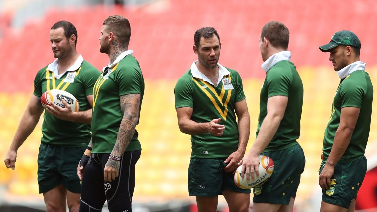 Aussie skipper Cameron Smith talks to his team-mates in training